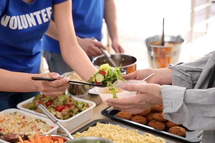 Volunteers serving food to the needy
