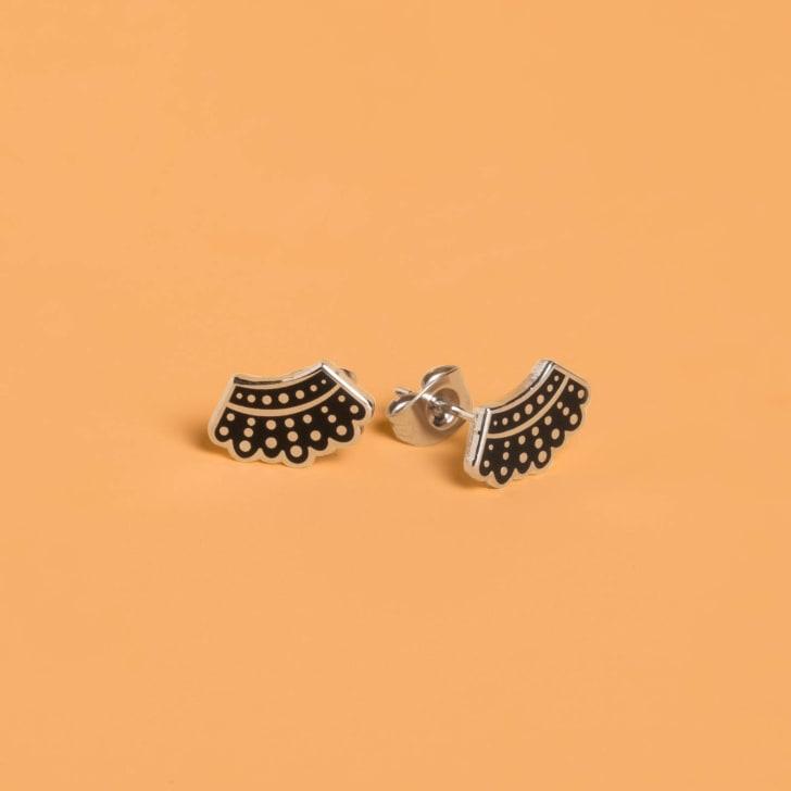 Ruth Bader Ginsburg collar earrings.