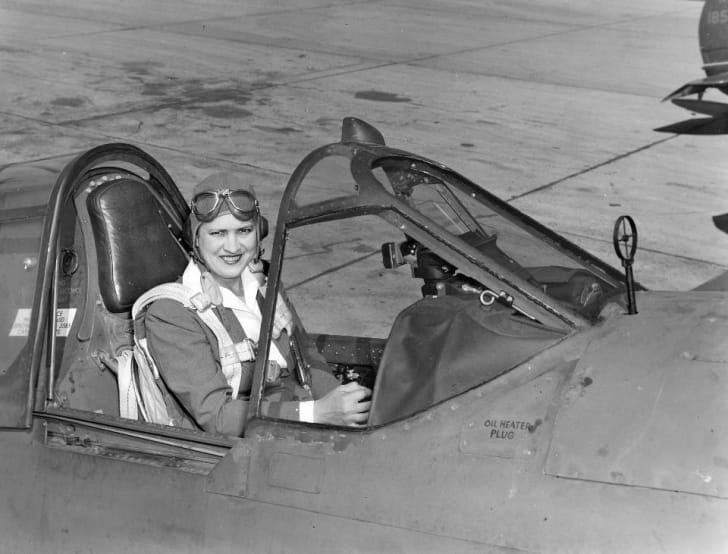 """Pioneer American aviator Jacqueline """"Jackie"""" Cochran in the cockpit of a Curtiss P-40 Warhawk fighter plane"""