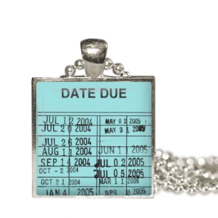 Necklace with library due date card charm.
