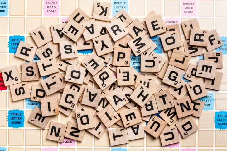 Scrabble tiles on the board