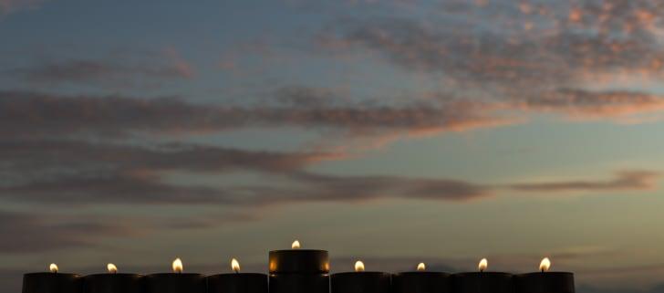 menorah lights on a skyline