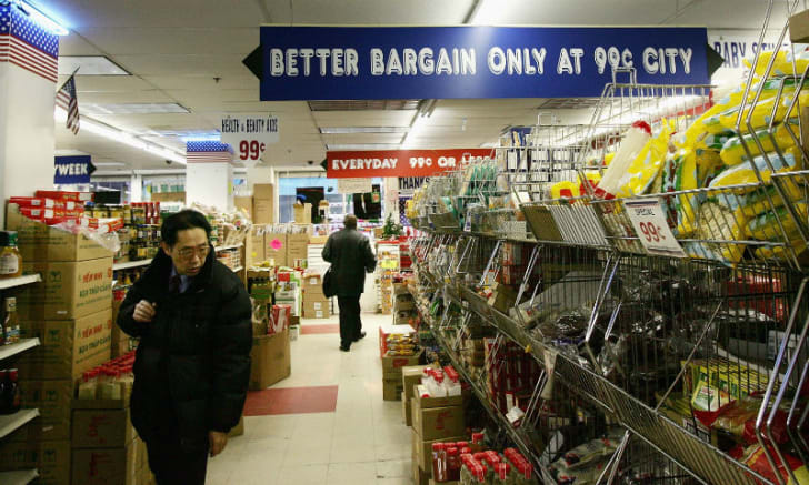 Shoppers browse the aisles of a dollar store