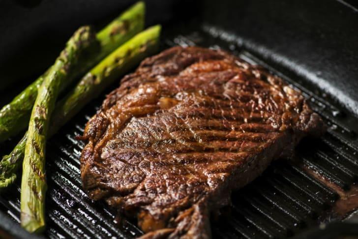 A steak sits on a grill