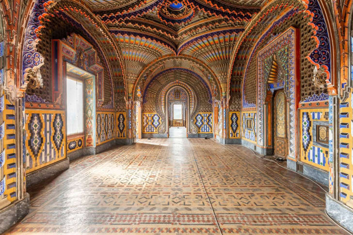 A room in Sammezzano Castle with arched ceilings and intricate tile work