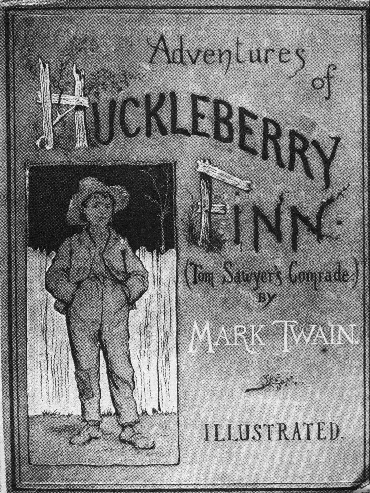 A cover of an old copy of Adventures of Huckleberry Finn