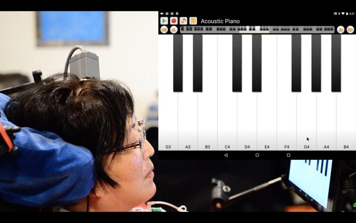 A participant plays a virtual piano