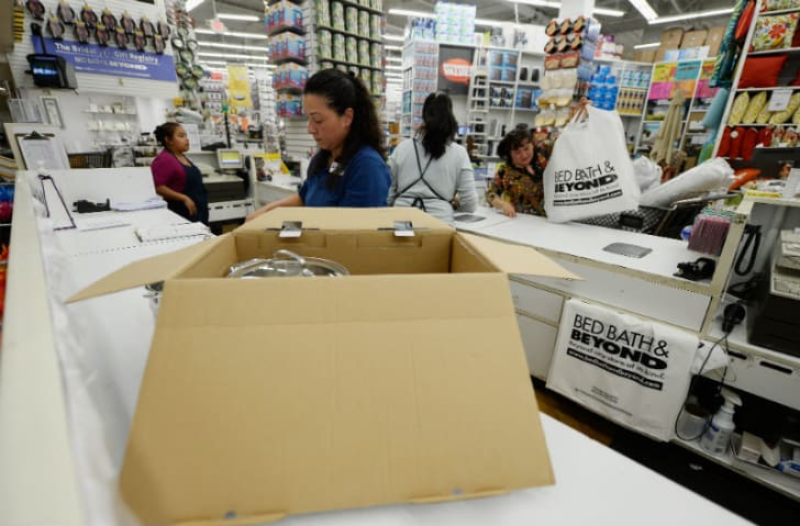 A Bed Bath & Beyond employee stands behind the counter