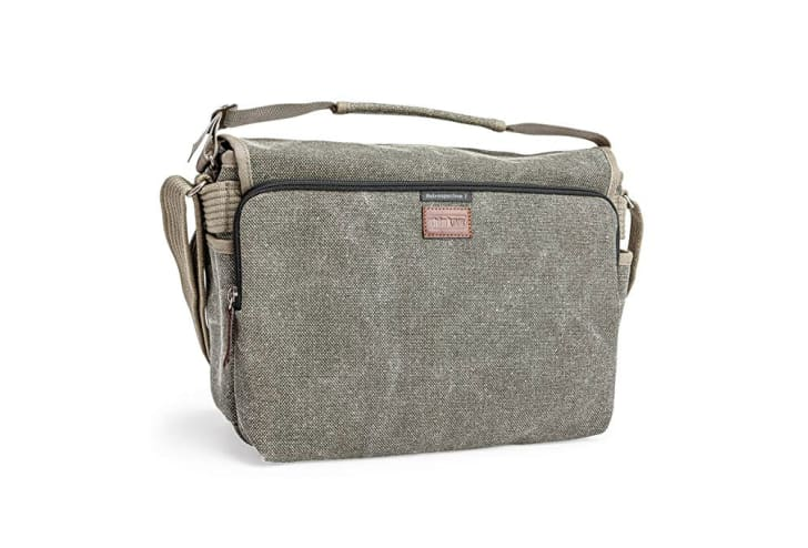A khaki-colored, messenger-style camera bag