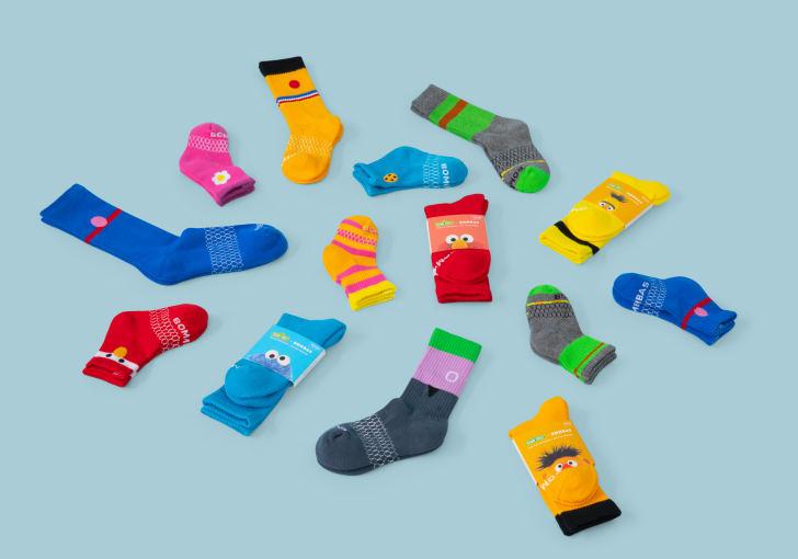Pairs of 'Sesame Street'-inspired socks arrayed on the floor