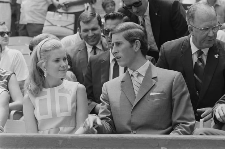 Prince Charles sits with Tricia Nixon during a baseball game at RFK Stadium while on a trip to Washington, D.C. in July 1970.