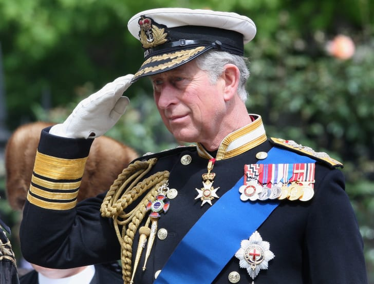 Prince Charles attends a naval event in uniform.