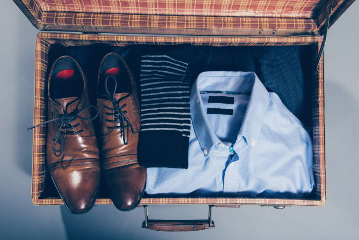 A suitcase with men's clothing inside