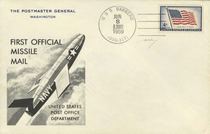 An envelope that reads 'First Official Missile Mail'