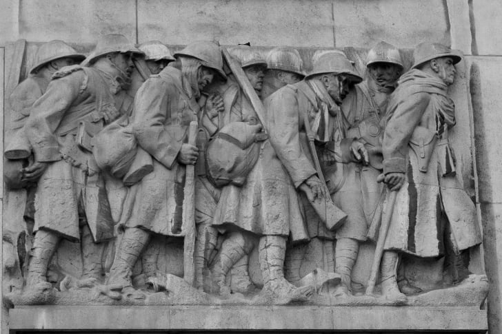 Soldiers carved into World War I memorial.