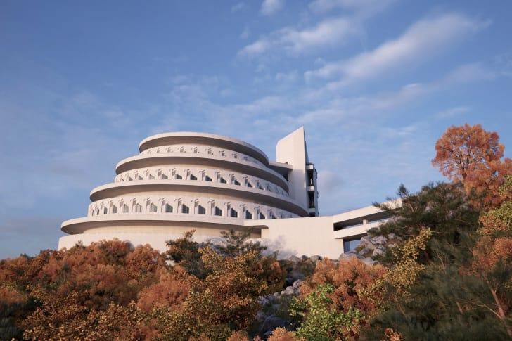 A spiraling building on top of a mountain