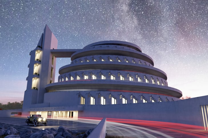 A rendering of a spiral-shaped building at night
