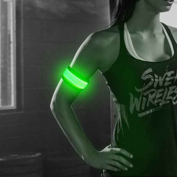 A woman wears the Higo LED slap armband