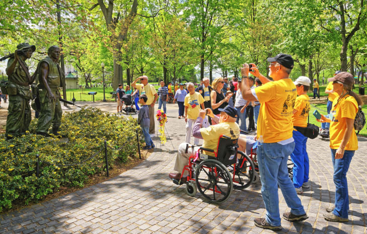 A group of veterans visit the Vietnam memorial in Washington D.C.