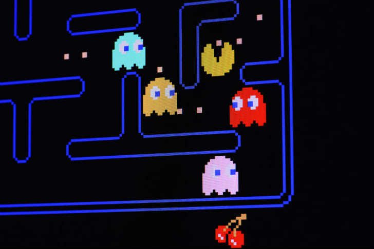 A 'Pac-Man' video game screen is shown