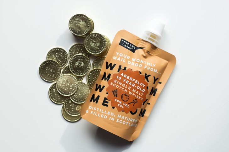 A single-malt Scotch pouch and vending machine tokens