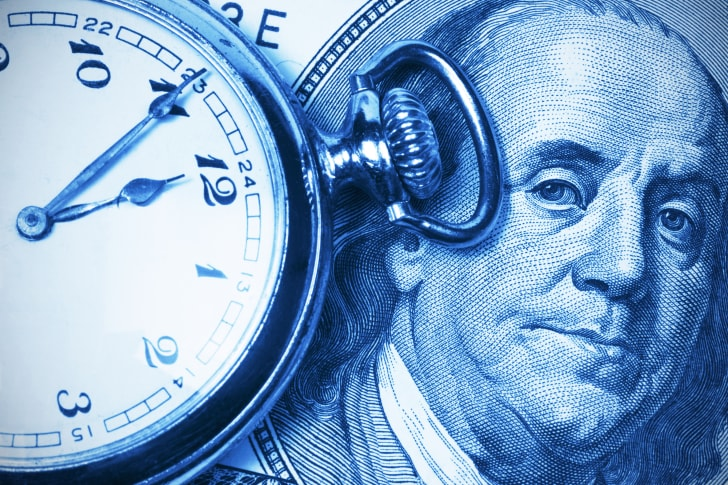 A pocketwatch and picture of Benjamin Franklin