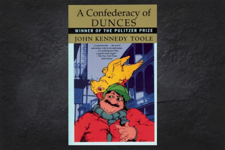 An image of the cover of A Confederacy of Dunces on a black background.