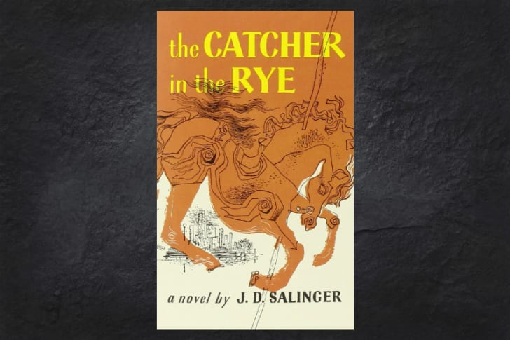 The cover of the book 'The Catcher in the Rye' on a black background.