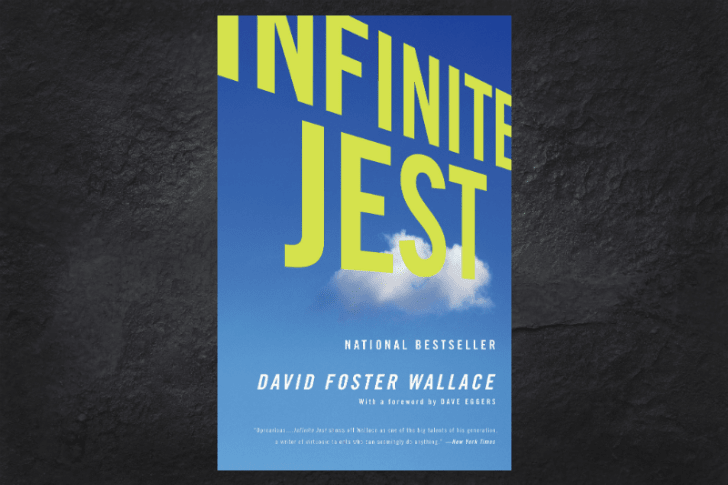 The cover of the book Infinite Jest on a black background.