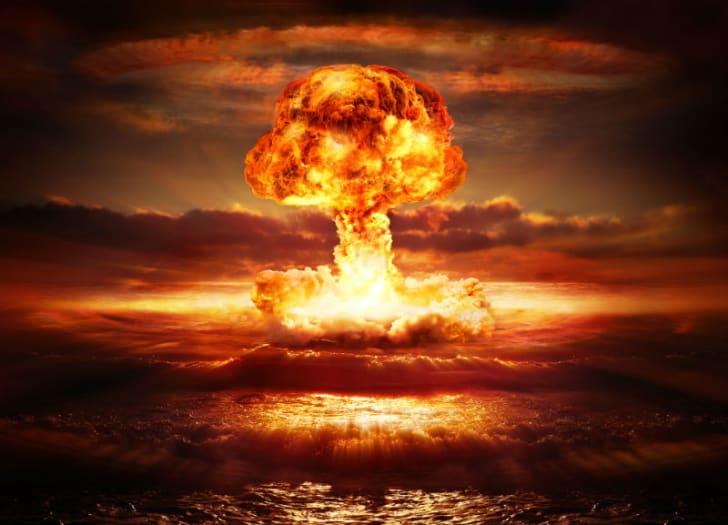A nuclear explosion creates a mushroom cloud