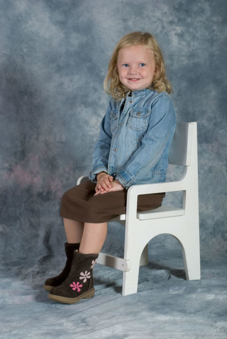 A child poses for a school photo