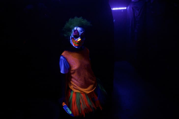 An actor in a scary clown costume at 'Terror Behind the Walls' in Philadelphia