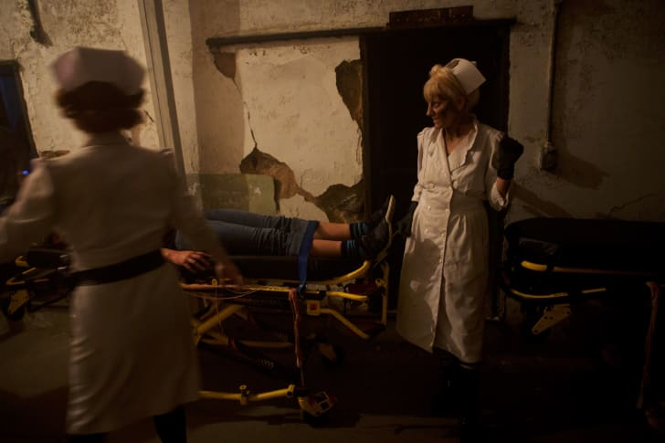Two actors in scary nurse costumes at 'Terror Behind the Walls' in Philadelphia