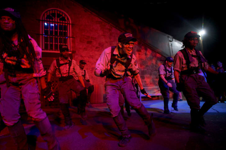 Actors perform at 'Terror Behind the Walls' haunted house in Philadelphia