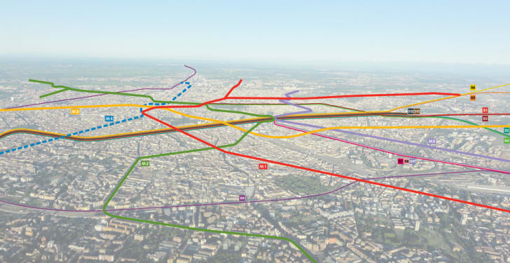 An aerial view of Milan with colored lines representing subway paths