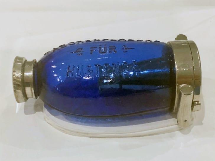 A blue sputum flask