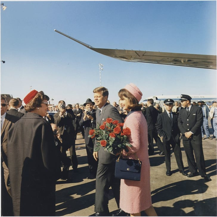 President and Mrs. Kennedy arriving at Dallas in 1963