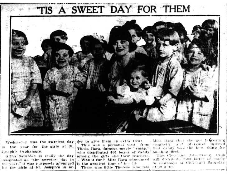 Actress Theda Bara giving candy to orphans in 1921.