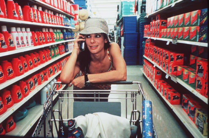 Sandra Bullock talks on a cell phone while shopping for laundry detergent in 1999's 'Forces of Nature.'