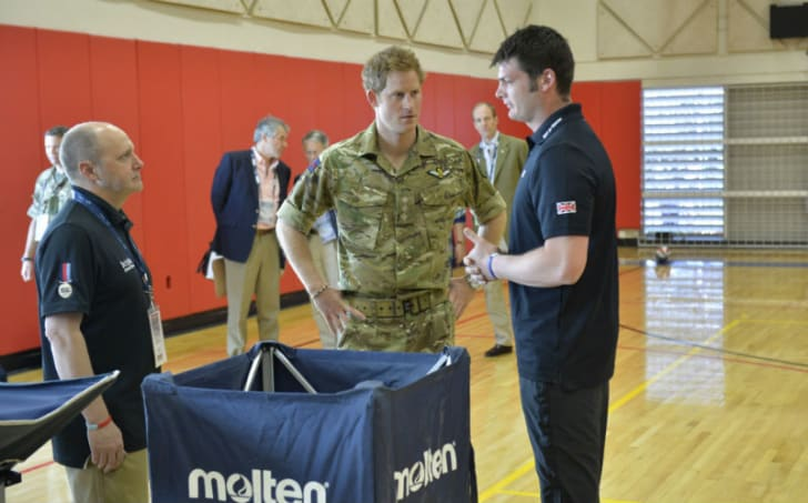 Prince Harry talks to a Warrior Games representative in the United States