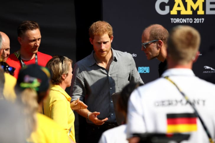 Prince Harry talks to representatives at the Invictus Games
