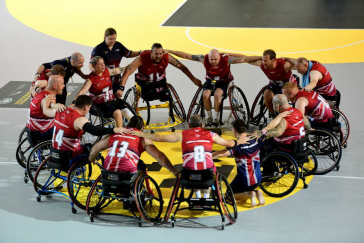 A group of athletes huddle during the Invictus Games
