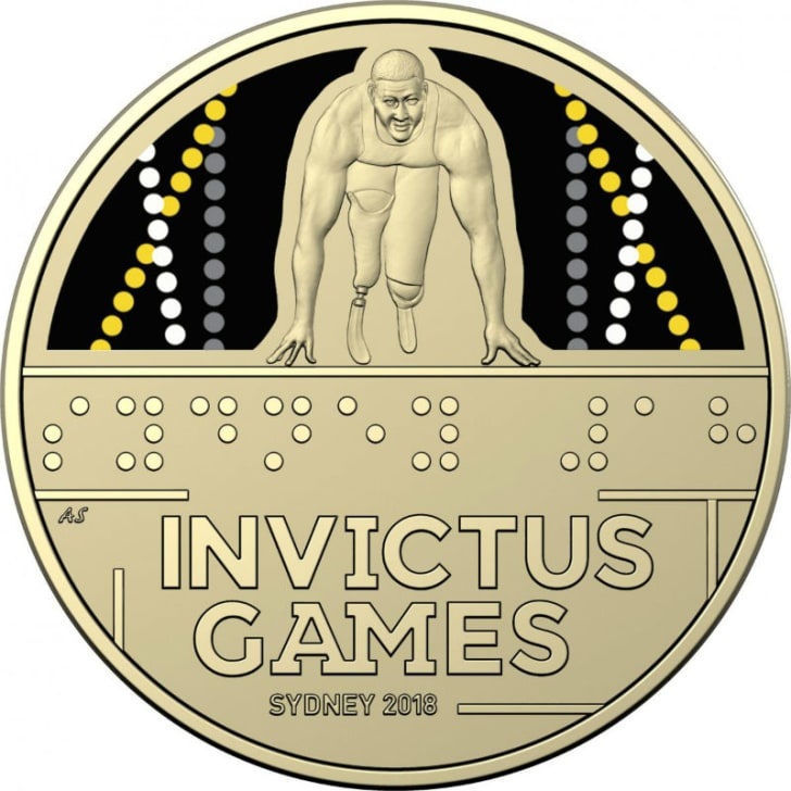 An Invictus Games commemorative coin features text in Braille