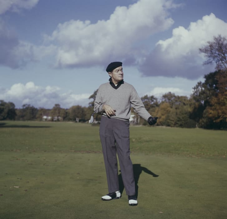 Bob Hope playing golf in England, circa 1965.