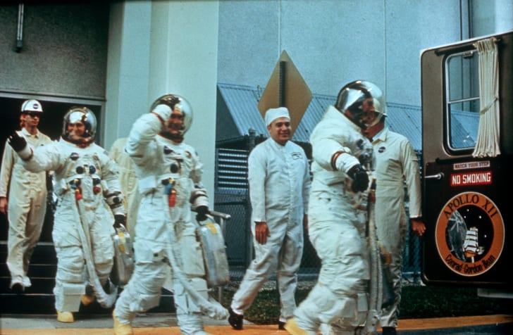 Astronauts Pete Conrad, Richard F Gordon Jnr, and Alan L Bean getting ready to go to the moon on the Apollo 12 mission.