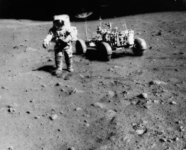 Apollo 15 Astronaut James Irwin on the moon with a moon buggy.
