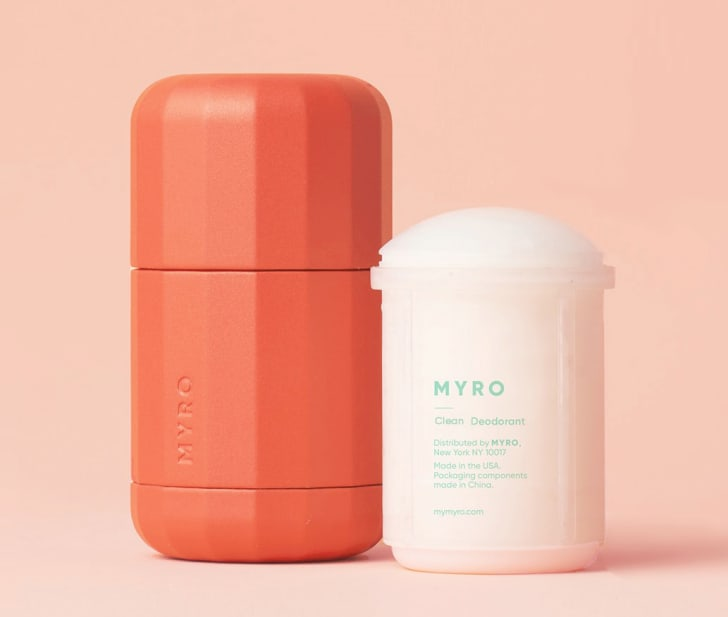 A red-orange deodorant canister next to a Myro refill pod