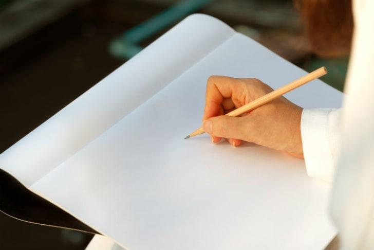 An artist sketches using a pencil