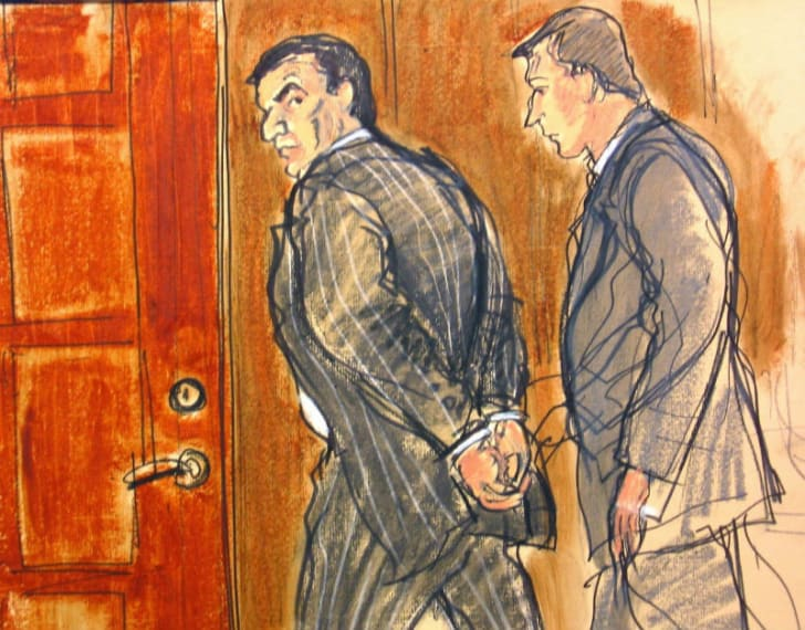 A courtroom sketch by Elizabeth Williams features Bernie Madoff accomplice Frank DiPascali being led away in handcuffs