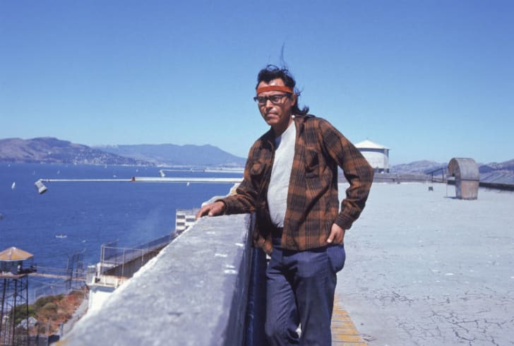 A man stands on Alcatraz Island during a Native American occupation